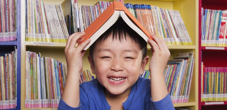 Boy with Book on His Head